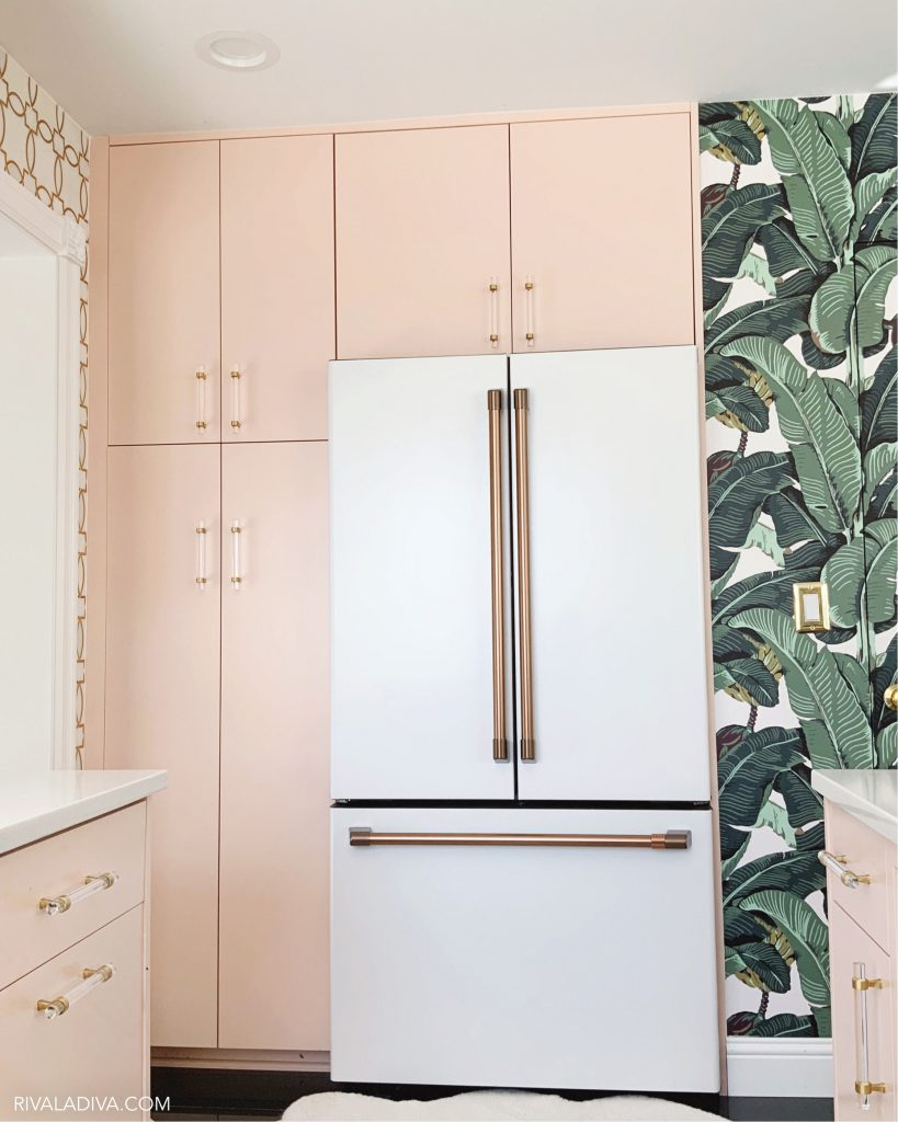 Beverly Hills inspired kitchen with Blush pink caninets and Cafe 23.1 cu. ft. Smart French Door Refrigerator in Matte White