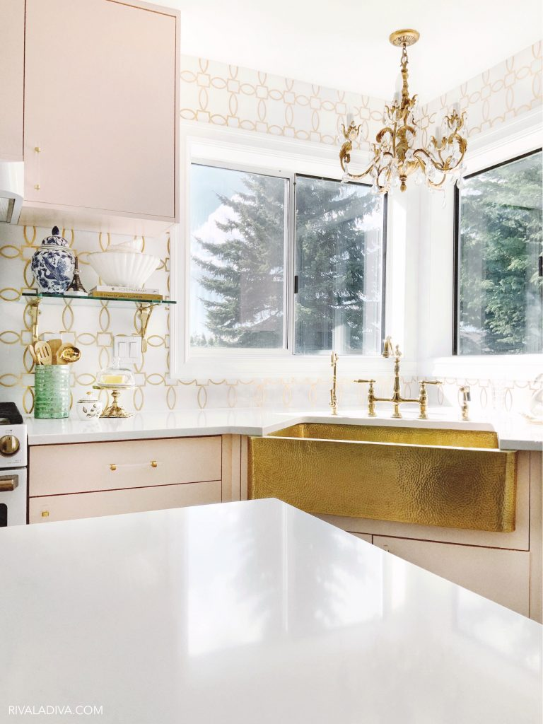 Glamorous Brass gold sink by Thompson Traders and vintage inspired Kingston Brass faucet.