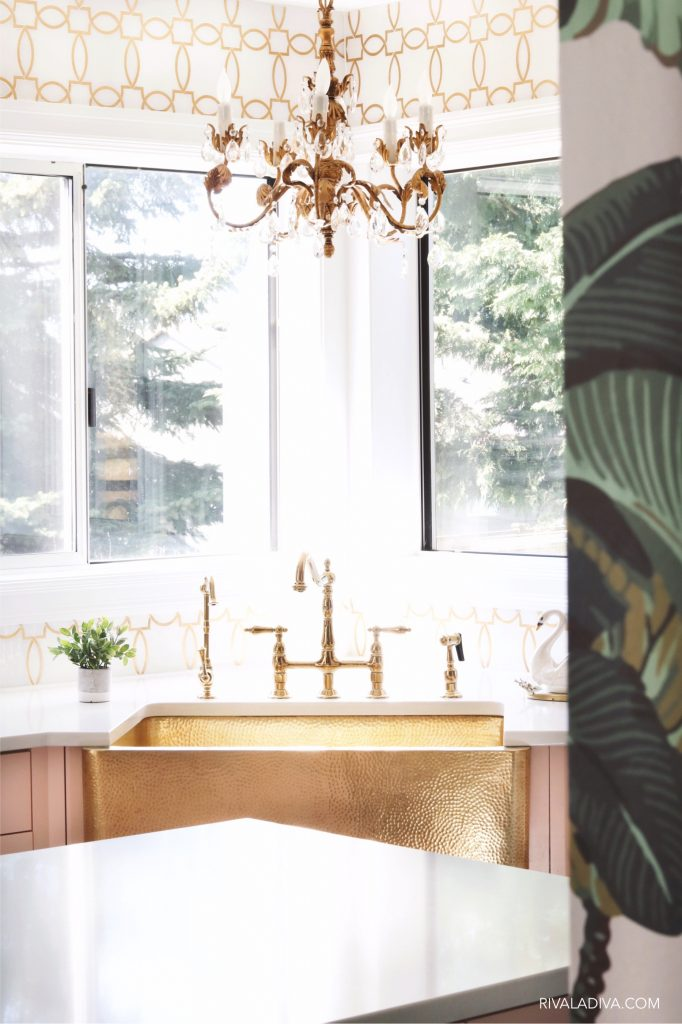 Glamorous Brass gold sink by Thompson Traders and vintage chandelier.