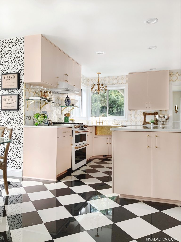 Glamorous Blush kitchen idea with vintage accessories, tiled floors and spotted wall. GE Cafe 30 in. 7.0 cu. ft. Slide-In Double Oven Range in Matte White